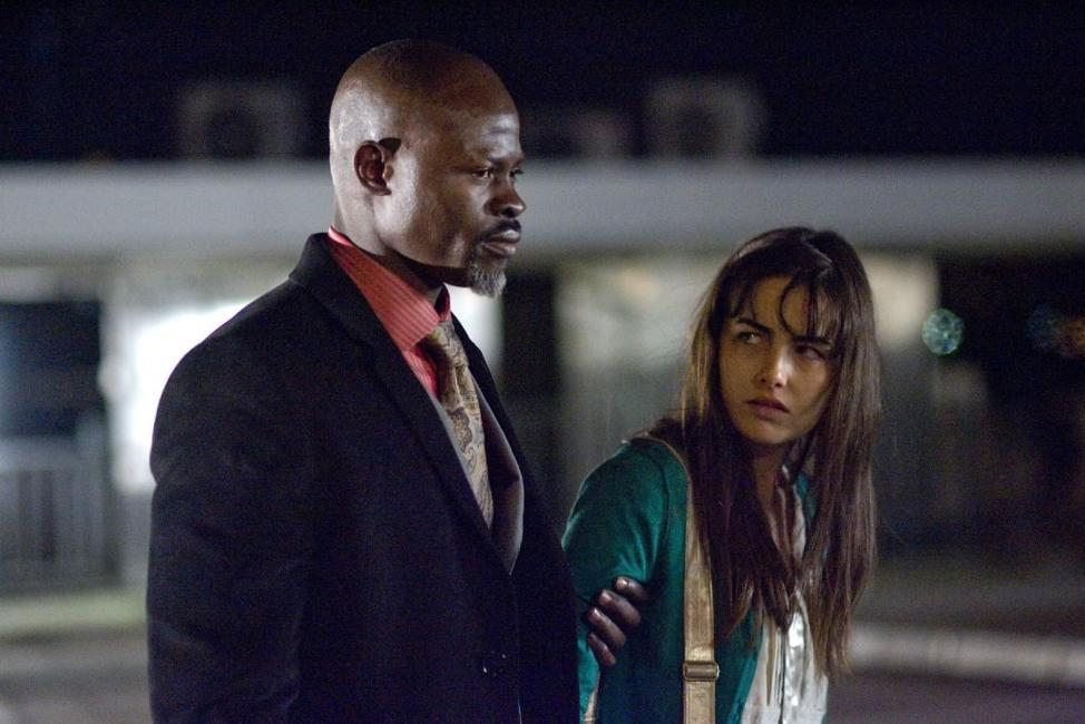 Camilla Belle as Kira Hudson and Djimon Hounsou as Agent Henry Carver in