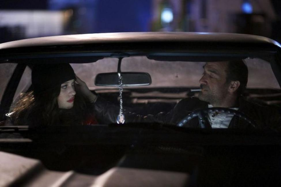 Kat Dennings as Kat and Elias Koteas as Dooney in