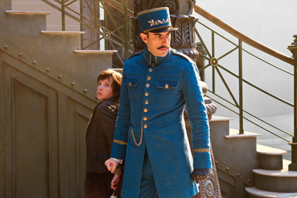 Asa Butterfield as Hugo Cabret and Sacha Baron Cohen as Station inspector in