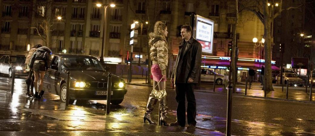 Liam Neeson as Bryan Mills and Fani Kolarova as a streetwalker in