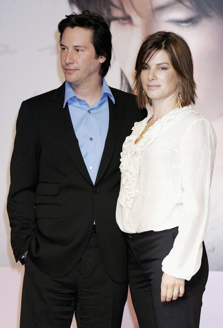 Keanu Reeves and Sandra Bullock at a press conference promoting