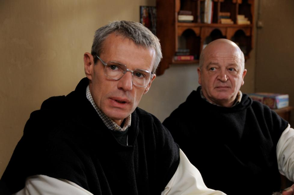 Lambert Wilson as Christian and Jean-Marie Frin as Paul in