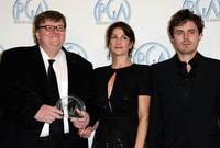 Michael Moore, Meghan O'Hara and Casey Affleck at the press room at the 19th annual Producers Guild Awards held at the Beverly Hilton Hotel.