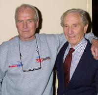 Paul Newman and friend at the premiere of