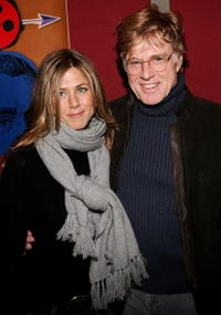 """Jennifer Anitston and Sundance Institute president Robert Redford  at the """"Friends with Money"""" opening night premiere in Park City, Utah."""