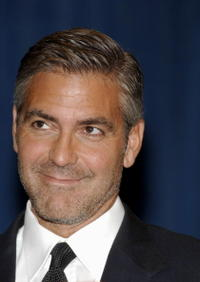 George Clooney at a bill signing for California Assembly Bill 2941.