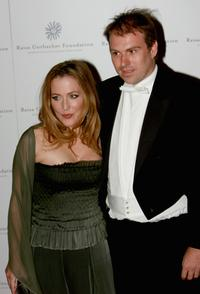Gillian Anderson and Guest at the Raisa Gorbachev Foundations Second Annual Gala Dinner.