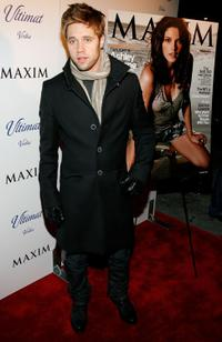 Shaun Sipos at the December Maxim Issue with Ashley Greene.