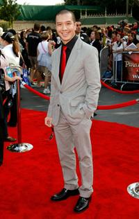 Reggie Lee at the premiere of