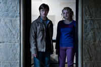 Daniel Radcliffe as Harry Potter and Evanna Lynch as Luna Lovegood in