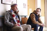 Woody Harrelson as Arthur and Michael Kelly as Paul Carter in