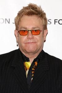 Elton John at the press conference to introduce the Elton John Fireside holiday collection.