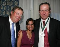 Tommy Lee Jones, John Gray and his wife Carrie at the Great Sports Legends Dinner at the Waldorf Astoria.