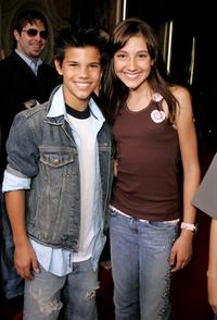 Taylor Lautner and Taylor Dooley at the premiere of