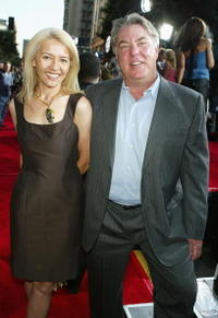 Bruce McGill and Guest at the world premiere of