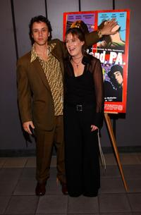 Billy Morrissette and Maura Tierney at the premiere of