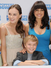 Madeline Carroll, Maxwell Perry Cotton and Carla Gugino at the premiere of