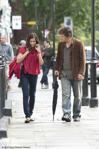 Freida Pinto as Dia and Josh Brolin as Roy in