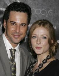 Jonathan Silverman and Jennifer Finnigan at the Macy's Passport auction and fashion show in celebration of it's 25th anniversary.