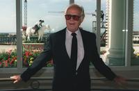 Richard Widmark poses on the balcony of the Deauville casino during the American Film Festival.