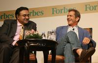 Mel Gibson and Vinod Sekhar at the Forbes Global CEO Conference.