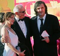 Emir Kusturica, his spouse and Nikita Mikhalkov at the opening ceremony of the XXIX Moscow international film festival.