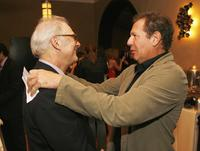 Barry Levinson and Garry Shandling talk at the Hollywood Roosevelt Hotel for the afterparty at the premiere of Universals