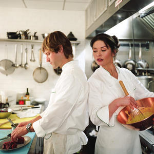 "Aaron Eckhart as Nick and Catherine Zeta-Jones as Kate in ""No Reservations."""