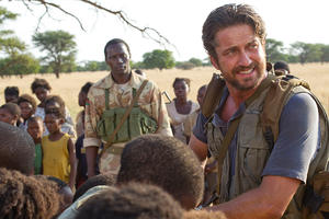 "Souleymane Sy Savane and Gerard Butler in ""Machine Gun Preacher."""