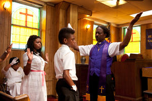 """Kimberly Hebert-Gregory as Sister Sweet, Tony Lysaith as Chazz Morningstar, Clarke Peters as Bishop Enoch Rouse and Jules Brown as Flik Royale in """"Red Hook Summer."""""""