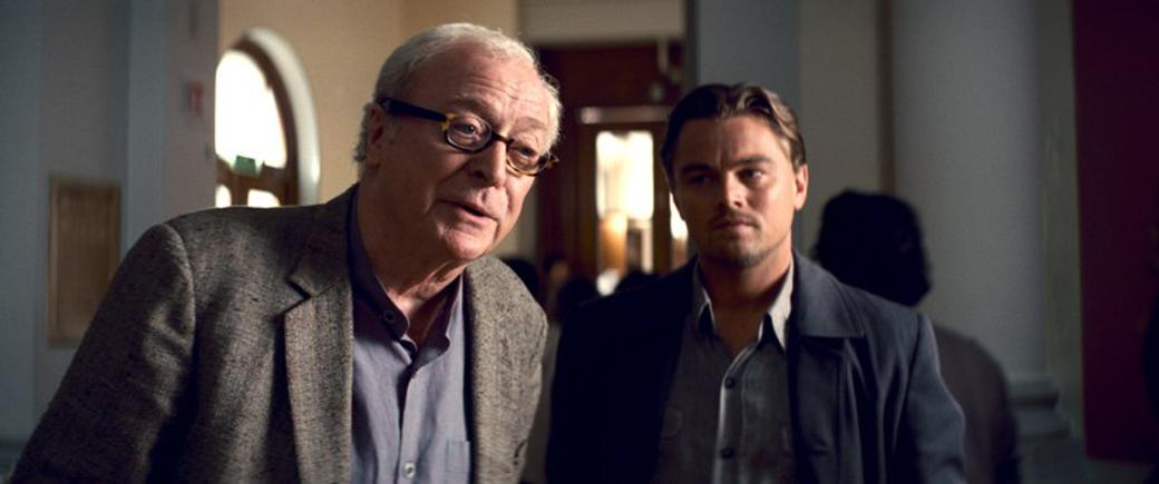 Michael Caine as Miles and Leonardo Dicaprio as Cobb in