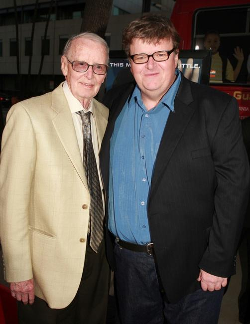 Michael Moore and his father Frank Moore at a special screening of
