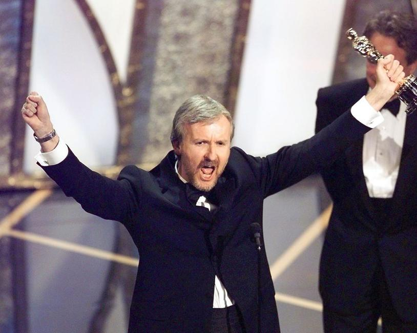 James Cameron at the 70th Academy Awards raises his Oscar after winning in the Best Director Category for his movie