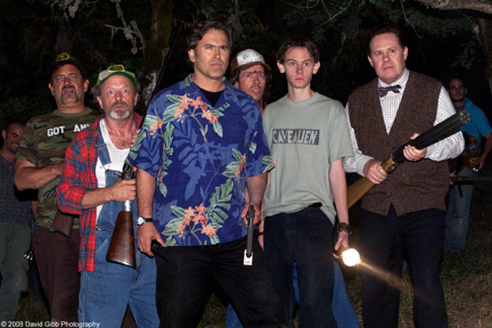 Bruce Campbell as himself, with townspeople, in