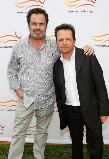 Dennis Miller and Michael J. Fox at the Michael J. Fox Foundation for Parkinson's Research Summer Lawn Party.