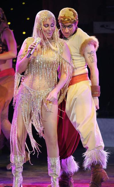 Cher and her dancer perform on stage at Zenith.
