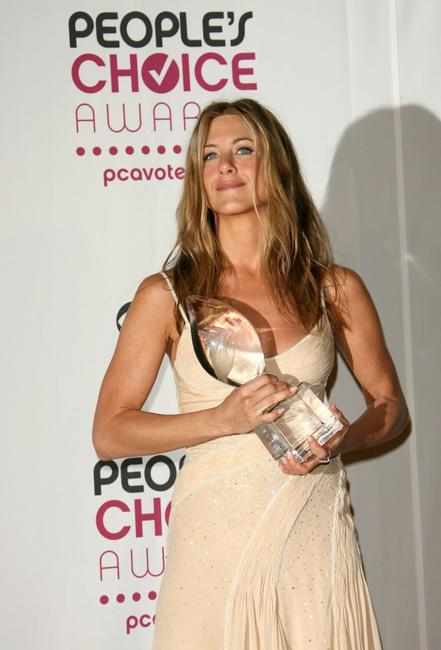 Jennifer Aniston at the press room during the 33rd Annual People's Choice Awards.