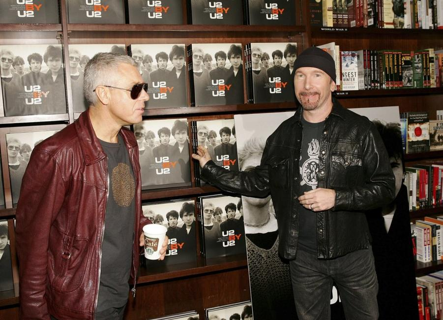 Adam Clayton and The Edge at the signing of the new book