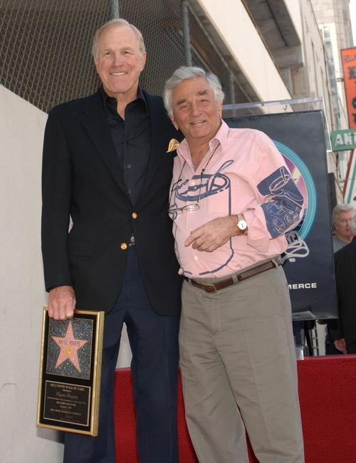 Peter Falk and Wayne Rogers attend a ceremony honoring Rogers with a star on the Hollywood Walk of Fame.
