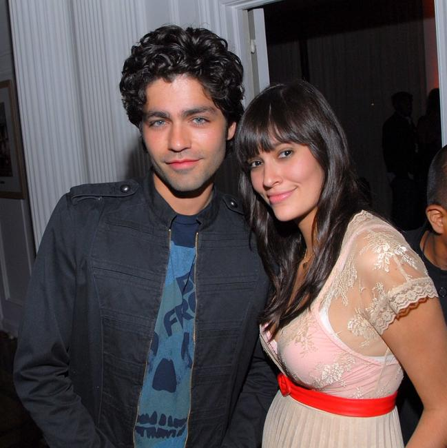 Adrian Grenier and guest at the launch party for the new BlackBerry Curve.