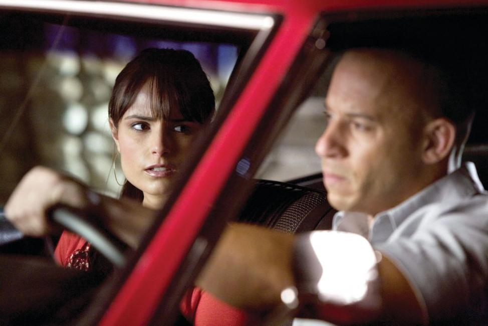 Jordana Brewster as Mia Toretto and Vin Diesel as Dom Toretto in
