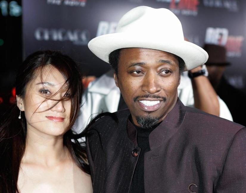 Eddie Griffin and guest at the premier of