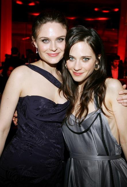 Emily Deschanel and sister Zooey Deschanel at the premiere of