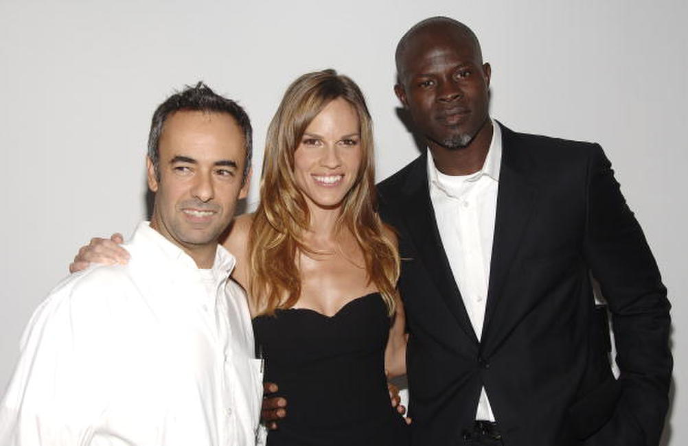 Djimon Hounsou, Francisco Costa and Hilary Swank at the 25th Anniversary Party of Calvin Klein Underwear.