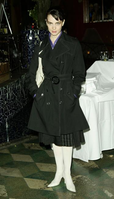 Mia Kirshner poses at the Cafe La Boheme for a Fashion Week event.