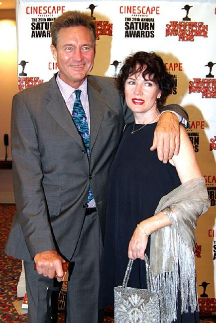 John Phillip Law and Guest at the 29th Annual Saturn Awards.