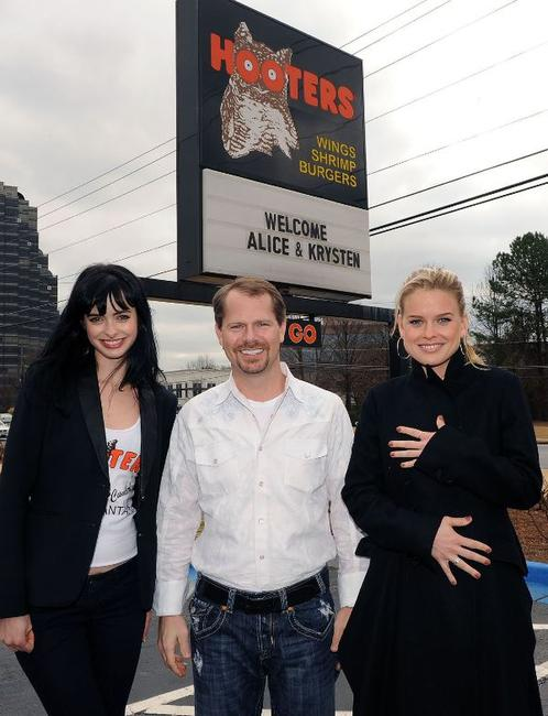 Krysten Ritter, Coby Brooks and Alice Eve at the Hooters in Atlanta, Georgia.