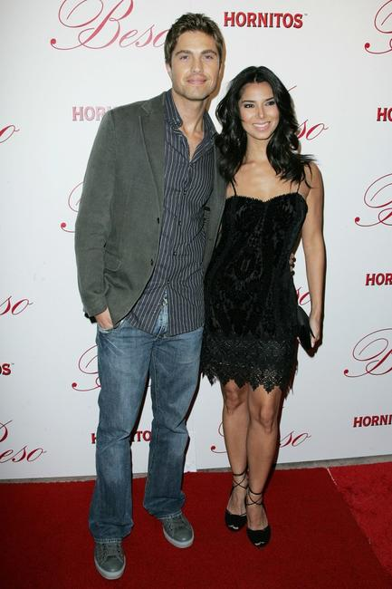 Eric Winter and Roselyn Sanchez at the grand opening of Eva Longoria Parkers new restaurant