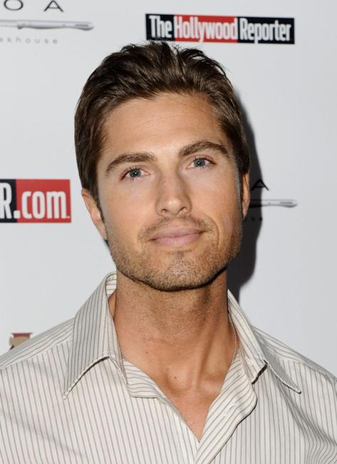 Eric Winter at the Hollywood Reporter's philanthropist of the year Award Reception.