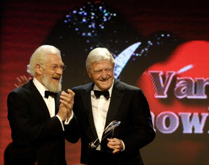 Sir Ian McKellen presents an award to Michael Parkinson at the Variety Club Showbiz Awards.
